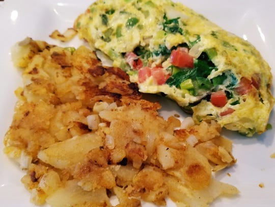 Sailfish Cafe's garden fresh omelet is three whipped