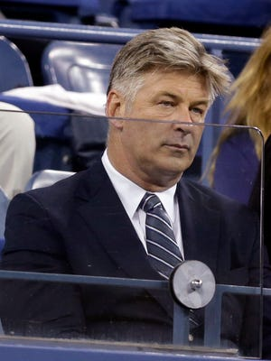 Alec Baldwin watches the match between Maria Sharapova, of Russia,  and Maria Kirilenko, of Russia, during the opening round of the U.S. Open tennis tournament Monday, Aug. 25, 2014, in New York.