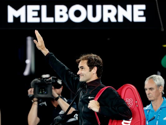 Switzerland's Roger Federer waves as he leaves Rod Laver Arena after defeating Tomas Berdych of the Czech Republic in their quarterfinal at the Australian Open tennis championships in Melbourne, Australia, Wednesday, Jan. 24, 2018. (AP Photo/Vincent Thian)