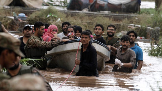 Pakistani Army soldiers rescue people from flooded areas east of Islamabad.