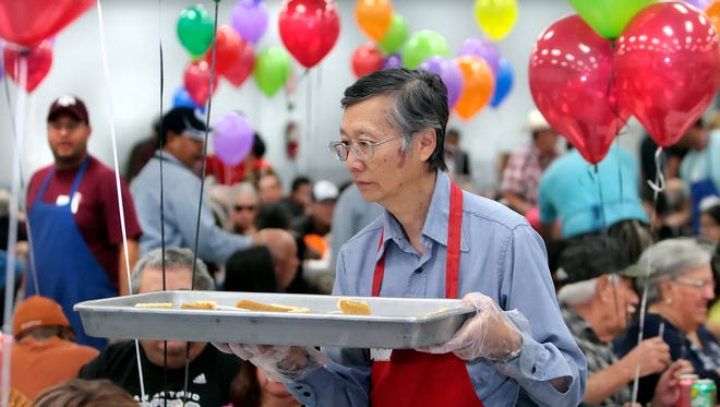 P.N. Lin brought pumpkin pies to diners, one of scores of volunteers who made the 2014 Joe Salem Thanksgiving Dinner a success.
