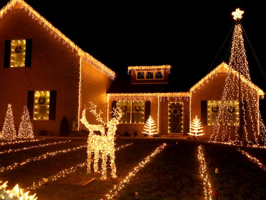 Shannon and Aaron Grimes offer a 20-minute lights show at their home in Ridgeside subdivision off Barfield Crescent Road in Murfreesboro.