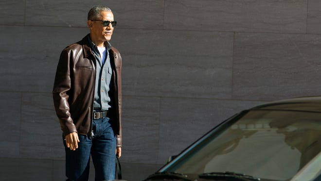 Former President Barack Obama leaves the National Gallery of Art in Washington, March 5, 2017.
