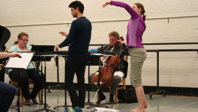 "Allison Offerman, oboe, Joshua Marquez, composer/conductor, Craig Hultgren, cello, Rebekah Chappell, choreographer/dancer, during a ""GRIT"" rehearsal."