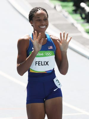 Allyson Felix cruised to victory in her 400 heat.
