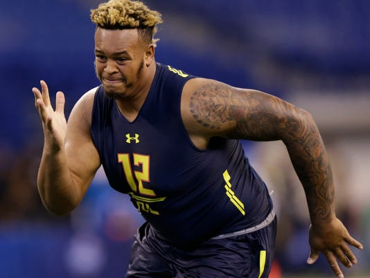 FILE - In this March 3, 2017, file photo, Temple offensive lineman Dion Dawkins runs a drill at the NFL football scouting combine in Indianapolis. The Minnesota Vikings were ultimately done in last season by a decimated offensive line. The draft this year won't be a quick fix for them or any of the other teams around the league lacking in proven, quality blockers, with a comparatively weak class of rookie offensive linemen entering the league.  (AP Photo/Michael Conroy, File)