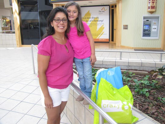 Alexa Topper, 5, of Painted Post, shown with her mother Jeannette Topper, will enter kindergarten next week at Erwin Valley Elementary School. They spent some time school shopping Monday at the Arnot Mall, Big Flats.