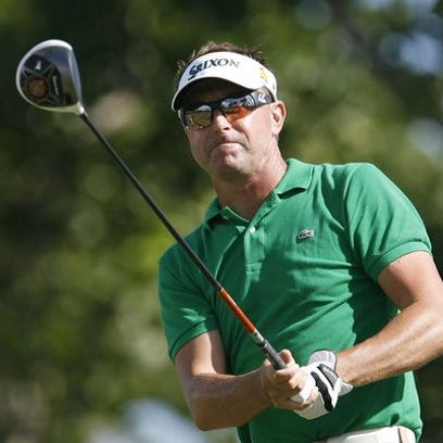 Robert Allenby of Australia follows his drive off the