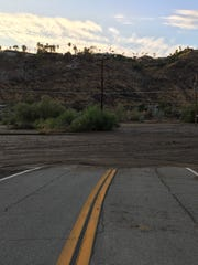 This Desert Sun file photo shows Araby Drive following a flood at the Araby Wash in Palm Springs. The Coachella Valley is under a flash flood  watch due to rainfall in local mountains.