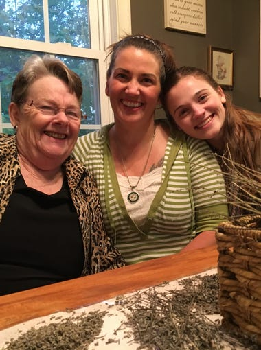 In her Staunton home on Thursday, Oct. 26, 2017, Nikki Narduzzi sits between her grandmother, Diana Andes Solomon, and daughter Maya Simmons. Diagnosed with Crohn's disease in 1999, Narduzzi advocates for the legalization of medical marijuana in Virginia. Two years ago, she began using cannabis oil to treat her disease.