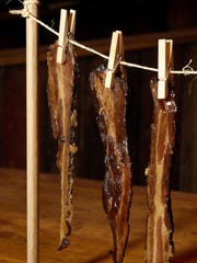 The new Grindstone Smokehouse offers an appetizer called pig candy. It's house-smoked, then maple syrup and sugar candied, served on a clothesline.