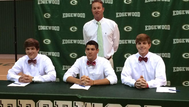Heath Young (left), Chase Laney (middle), Taylor Hawthorne (right) and coach Bobby Carr (top) at a signing ceremony at Edgewood on May 14, 2014