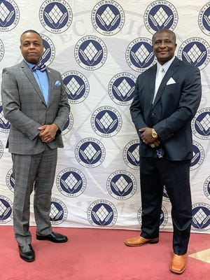 Denmark Technical College President Dr. Willie L. Todd Jr. (left) with new head basketball coach Andre Payne.