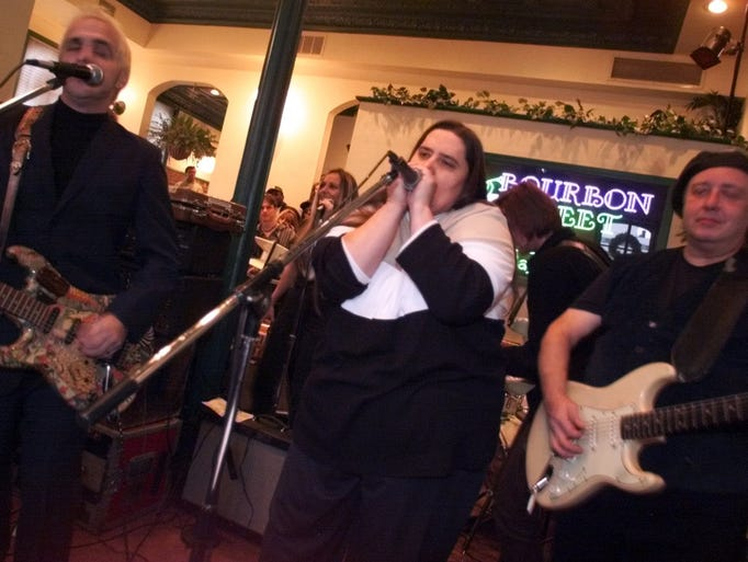 Big Nancy Swarbrick (center) jams on the harmonica