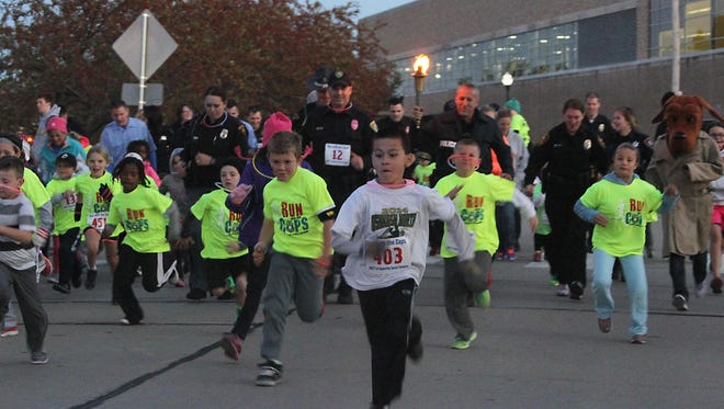 Children filled the street along with law enforcement officers as the Run with the Cops event for Special Olympics was held last October on the UW-Oshkosh campus.