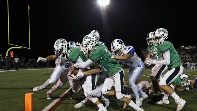 Dublin Coffman's Ian Carroll gets a little push from teammate Brady Broskie to score a  touchdown in Friday's 49-0 win over Hilliard Davidson. Coffman was ranked second in Division I in last week's state poll.