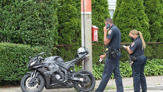 Brockton police officers investigate after a motorcyclist was involved in a crash with a minivan at the intersection of Elliot and Emmet streets in Brockton, Monday, June 22, 2020.