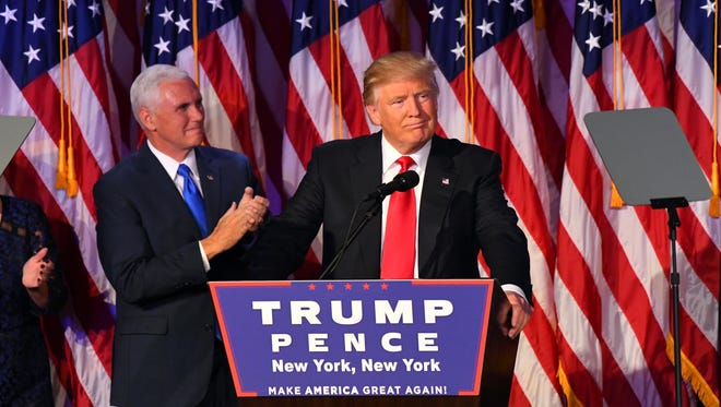 Nov 8, 2016; New York, NY, USA;   President-elect Donald Trump speaks to supporters at New York Hilton Midtown on election night.  Vice President Elect Mike Pence is at left. Mandatory Credit: Robert Deutsch-USA TODAY NETWORK ORG XMIT: USATSI-353736 ORIG FILE ID:  20161108_pjc_usa_162.JPG