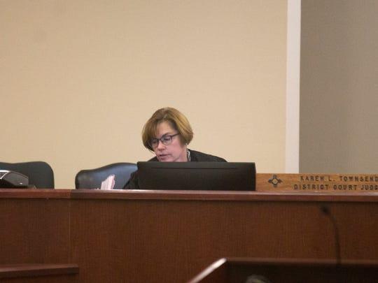Judge Karen Townsend sentences defendant Anna Marie Schroth on Tuesday in Aztec District Court.