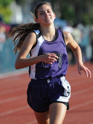 Skye Zeller of Space Coast wins the 800 during the Cape Coast Conference track and field meet in Titusville.