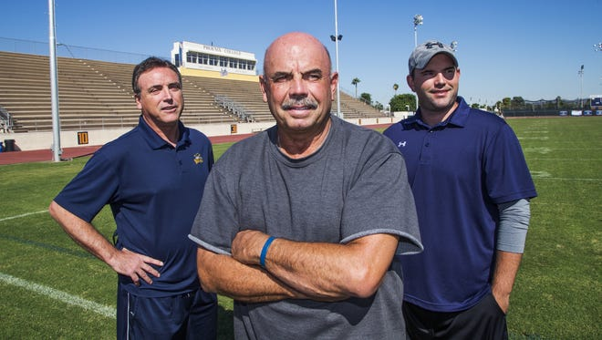The Phoenix College football staff includes, from left; Robin Pflugrad, assistant head coach, Dan Cozzetto, head coach, and Herb Pierce, co-offensive coordinator.