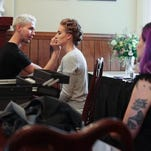 Mikhail Schulz, left, works on hair and makeup for Jade Brownfield during a HerScene fashion shoot at St. John United Church of Christ. May 28, 2015