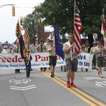 The Jeffersonville Celebrates Freedom Parade made its way up Spring Street in downtown Jeffersonville on Saturday. (By Jenna Esarey, special to The Courier-Journal) July 4, 2015