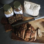 Small World Food makes bread, granola and more. Lauren Petracca Small World Food makes breads, flours, granola, and sweets in their bakery. They sell their products at local farmer's markets.