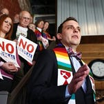 Rev. Caleb Lines, of South Street Christian Church, explains why he is against repealing the expanded nondiscrimination ordinance during an event at The Old Glass Place.