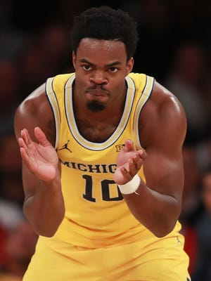Derrick Walton Jr. of the Michigan Wolverines celebrates against Southern Methodist on Nov. 18, 2016, in New York.