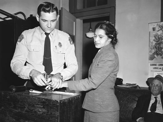 Rosa Parks is fingerprinted by police Lt. D.H. Lackey