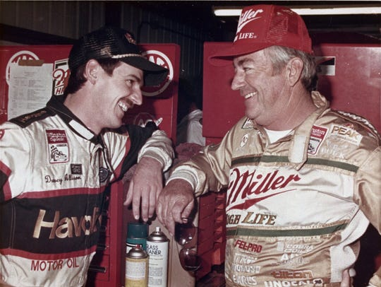 Davey Allison, left, talks with this father Bobby Allison