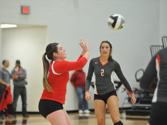 Bailey Agin digs a Lady Flyers serve in the district final.