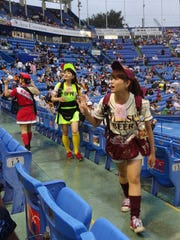 The beer girls at Meiji Jingu Stadium in Tokyo take orders moments before a game between the Yomiuri Giants and the home team Tokyo Yakult Swallows.