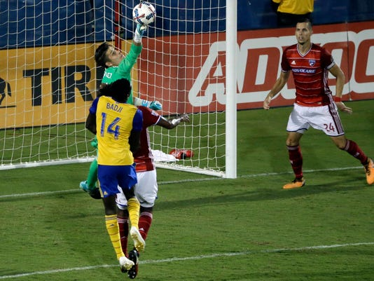 FC Dallas goalkeeper Jesse Gonzalez, rear, deflects a shot under pressure from Colorado Rapids's Dominique Badji (14) as Atiba Harris, center left, and Matt Hedges (24) help defend in the second half of an MLS soccer game, Saturday, Aug. 12, 2017, in Frisco, Texas. (AP Photo/Tony Gutierrez)