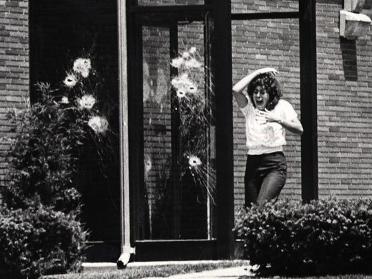 -  A hostages flees the Security Trust Branch on Thurston Road in Rochester, NY June 17, 1981 seconds after William Griffin was killed by police. He killed three people before the police were able to stop him.