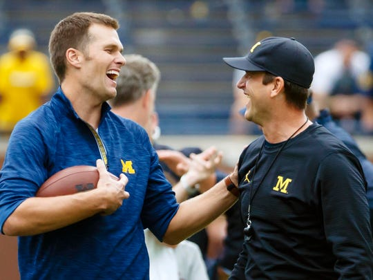 Sep 17, 2016; Ann Arbor, MI, USA; New England Patriots quarterback Tom Brady and Michigan Wolverines head coach Jim Harbaugh laugh during warm ups prior to the game against the Colorado Buffaloes at Michigan Stadium. Mandatory Credit: Rick Osentoski-USA TODAY Sports