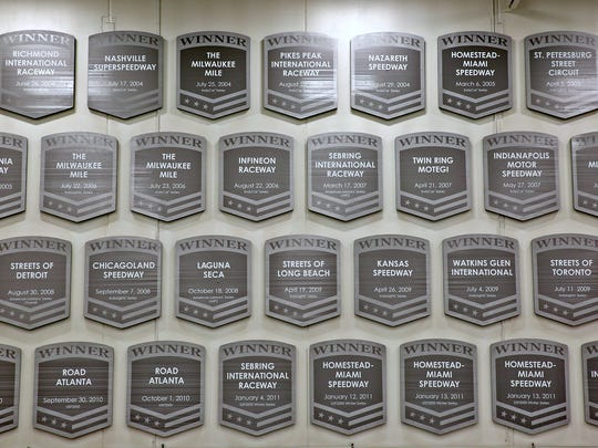 A wall of plaques marking  Andretti Autosport wins at the team's Northwest Indy shop.