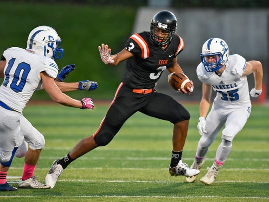 Tech's Brevyn Spann-Ford carries the ball during the