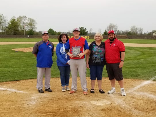 Union City's Gabe Loesch (center) was awarded the Monte