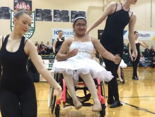 A WOW dancer smiles as she completes the dance routine.