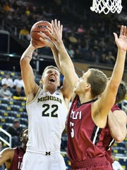 Michigan guard Duncan Robinson (22) could see an expanded