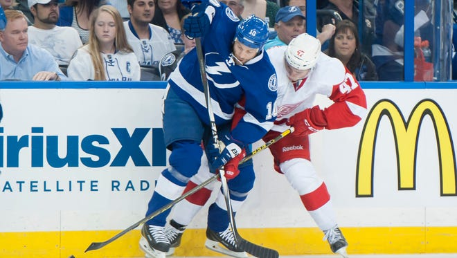 Detroit defenseman Alexei Marchenko and Tampa Bay left wing Brenden Morrow battle for the puck in the first period.