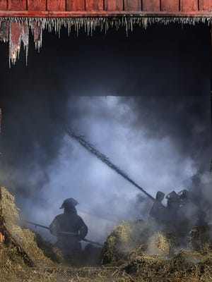 This February 2015 photo of firefighters battling a barn fire in the Town of Greenville earned Wm. Glasheen a second place award in spot news from the Wisconsin News Photographers Association.