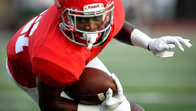 Brentwood Academy's Tahir Annoor (21) dives in just short of the end-zone against Hillsboro during the first half at Brentwood Academy in Brentwood, Tenn., Friday, Aug. 18, 2017.