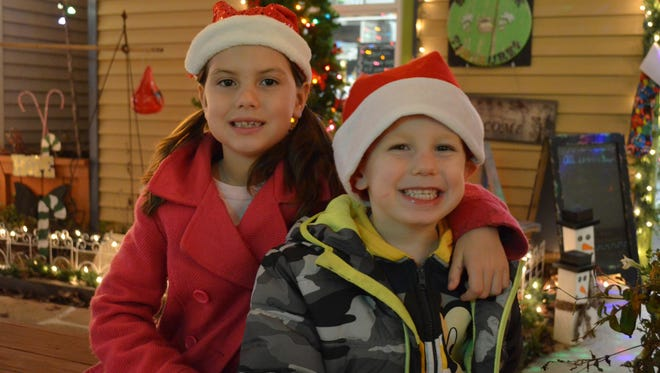 Alexandra Grubb, 8, and Mark Grubb, 4, of Millville relax at The Village on High during Soul of the Season.
