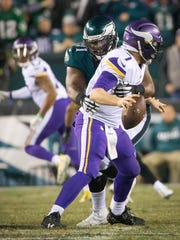 Eagles defensive tackle Fletcher Cox tackles Vikings quarterback Case Keenum in NFC title game.