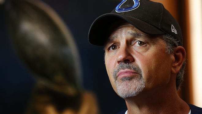 The Indianapolis Colts head coach Chuck Pagano talks to Mike Chappell following the final day of minicamp Thursday, June 19, 2014, afternoon at the Colts Complex in Indianapolis.  Matt Kryger / The Star