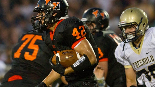 MIddletown North's Chad Freshnock runs for a touchdown. Freehold Boro at Middletown North football. Middletown, NJ September, 5 2014 Doug Hood/Staff Photographer