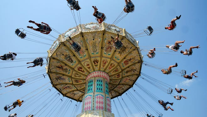 People ride the swing at the Dutchess County Fair in Rhinebeck.